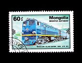 MONGOLIA - CIRCA 1979: A stamp printed in Mongolia shows 1970 train Moscow - Ulan Bator, circa 1979