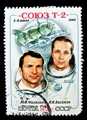 USSR - CIRCA 1980: A stamp printed in the USSR shows Soviet cosmonauts Malyshev and Aksenov and spa