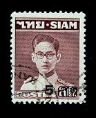 THAILAND - CIRCA 1950-th: A stamp printed in Thailand shows image of King Bhumibol Adulyadej, the world's longest serving head of state, series, circa 1950-th