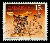 ZIMBABWE - CIRCA 1990: A stamp printed in Zimbabwe shows image of a Antique gold headrest, series, circa 1990