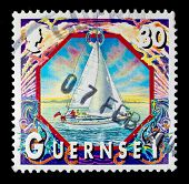 CHANNEL ISLANDS - BAILIWICK OF GUERNSEY - CIRCA 1990s: a stamp showing an image of people sailing of
