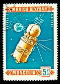 MONGOLIA - CIRCA 1961: A stamp printed in Mongolia shows the Soviet  Satilite Vostok-2, circa 1961.
