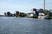 picture of flatboat  - Summer housing at water and flat boat  - JPG