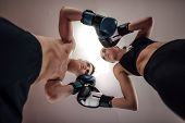 Low Angle View Of Man And Woman At Kick Boxing Fighting Position. Portrait Of Male And Female Kick B poster