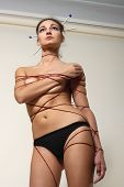 woman beautiful constrained with thread