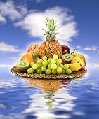 Basket Of Fruit On Sky And Water.