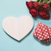 Valentines Card With Space For Text, Bouquet Red Roses, And Giftbox On Blue. Copy Space. View From  poster