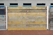 Facades Covered With Wooden Planks To Protect Against Winter Weather And Sea Storms poster