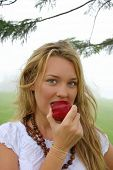 Beautiful girl eating a healthy apple