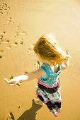 cute little girl at the beach in summer