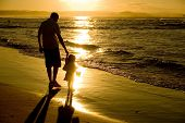 image of father daughter  - Father and Daughter playing at the beach - JPG