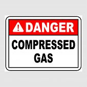 Plate: danger. Compressed Gas. Sign: danger. Compressed Gas On A Gray Background poster