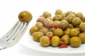 closeup a plate with olives as a spanish tapa
