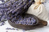 Dried Lavender Bunch, Lavender Flowers In Wooden Bowl And Textile Sachet Pouch On A White Rustic Woo poster