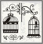 picture of caged  - Vintage bird cages with ornamental decorations - JPG