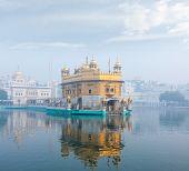 Sikh gurdwara Golden Temple (Harmandir Sahib) in morning fog. Amritsar, Punjab, India