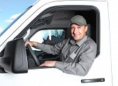 stock photo of movers  - Smiling truck driver in the car - JPG