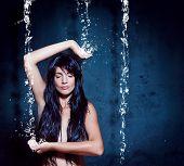 water-spa 02/girl meditating under waterfall
