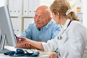 picture of observed  - doctor talking to her male senior patient at office - JPG