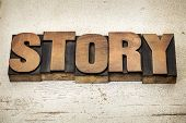 story - a word in vintage letterpress wood type on a grunge painted barn wood background