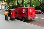 Royal Mail man collecting the post