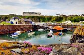 stock photo of lichenes  - View of boats and a lifeboat in Portpatrick harbour in southwest Scotland - JPG