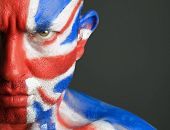 Man With His Face Painted With The Flag Of United Kingdom