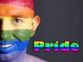 Gay flag painted on the face of a man