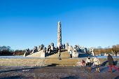 OSLO NORWAY- JANUARY 1: Visitors enjoying the statues created by Gustav Vigeland in the popular Vigeland park in Oslo, Norway on January 1, 2013.
