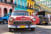 HAVANA-JUNE 21:Old Chevrolet parked near a row of colorful buildings on June 21, 2013 in Havana.These classic cars are a worldwide famous sight and a tourist attraction of the island