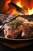 t-bone steak in the frypan