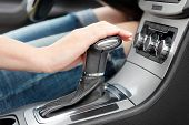 image of gear-shifter  - hand on automatic gear shift woman in luxury car - JPG
