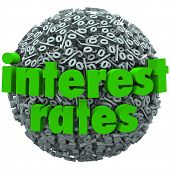 The words Interest Rates on a sphere of percentage signs to illustrate comparing bank fees and perce