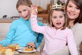 pic of epiphany  - Woman and little girls celebrating Epiphany - JPG