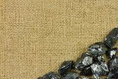 Raw Coal On Sack Background