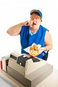 Unhygienic fast food worker sneezing on someone's meal.  White background.