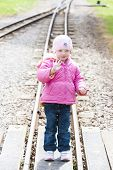 little girl at Ravenglass and Eskdale narrow gauge railway, Cumbria, England
