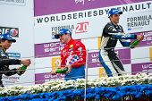 MOSCOW - JUNE 23: The winners of Formula Renault 2.0 race splashing each other with champagne at Wor