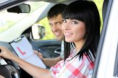 Beautiful young woman  taking driving lesson