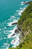Majestic rocky and ocean view from famous trail between Monterosso and Vernazza, Italy.