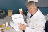 foto of inference  - A physician is tied up with a load of bureaucratic paperwork preventing him from doing his job - JPG
