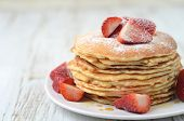 Freshly Prepared Pancakes With Strawberries