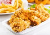 foto of southern fried chicken  - fried chicken on a plate on a table - JPG