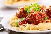 stock photo of pasta  - pasta with meatballs and parsley with tomato sauce - JPG