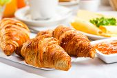 stock photo of continental food  - breakfast with plate of fresh croissants and jam - JPG
