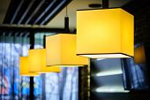 Modern restaurant interior with yellow square lamps