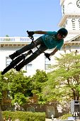 Teen Practices Bmx Jumping Tricks For Athens Competition