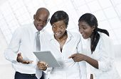 Three African Business People With Tablet Pc