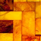Closeup Of Golden Amber Mosaic As Background Or Texture. Gem.