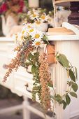 Shabby Chic Decor, White Table With Vintage Objects On It, Flowers Vase, Flower Pot, An Opened Book
